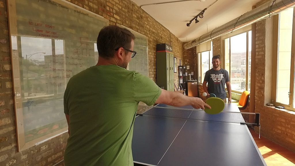 The Big Foot Media team enjoys some down time with their new ping pong table.