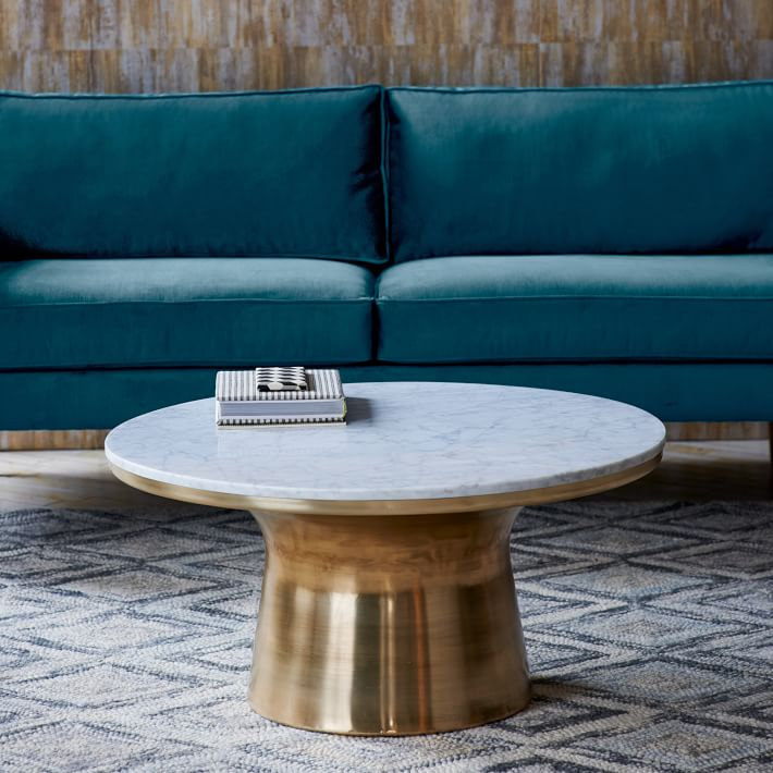brass West Elm coffee table with high metallic shine next to bright teal couch