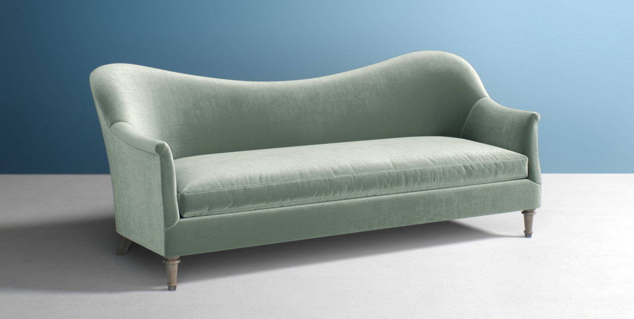 abstract-lined couch that follows a more organic curve in light green