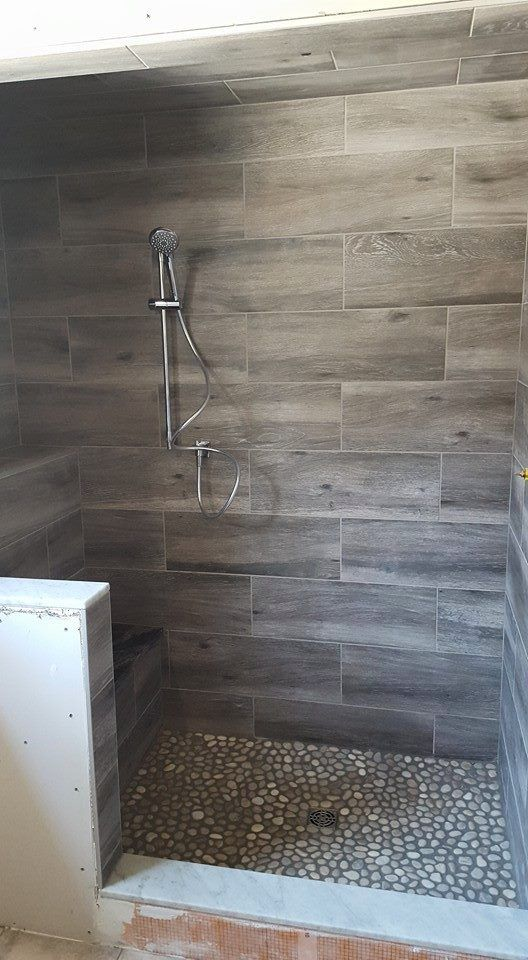 Wood Looking Tiles In The Shower And Bathroom