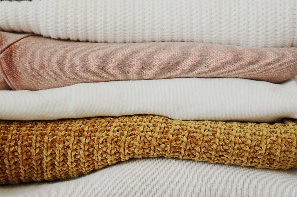Linens stacked on top of each other.