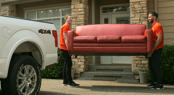 Two Helpers carrying a couch